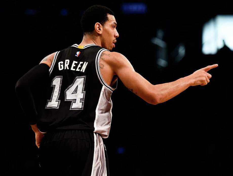 The Spurs' Danny Green celebrates a basket in the second half against the Brooklyn Nets on Dec. 3. Photo: Alex Goodlett / Alex Goodlett / Getty Images / 2014 Getty Images