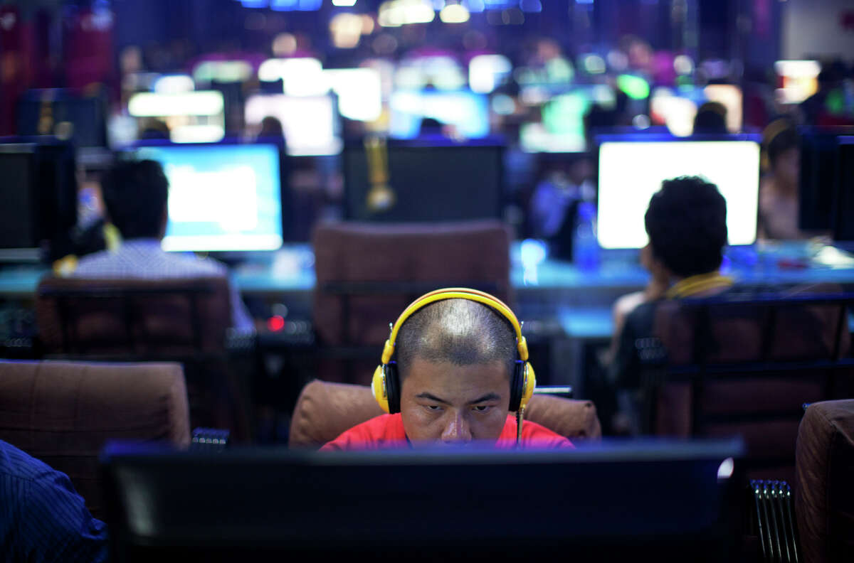 Computer users, like these people at a Beijing Internet cafe, are gradually realizing that hacking has become a more serious threat.