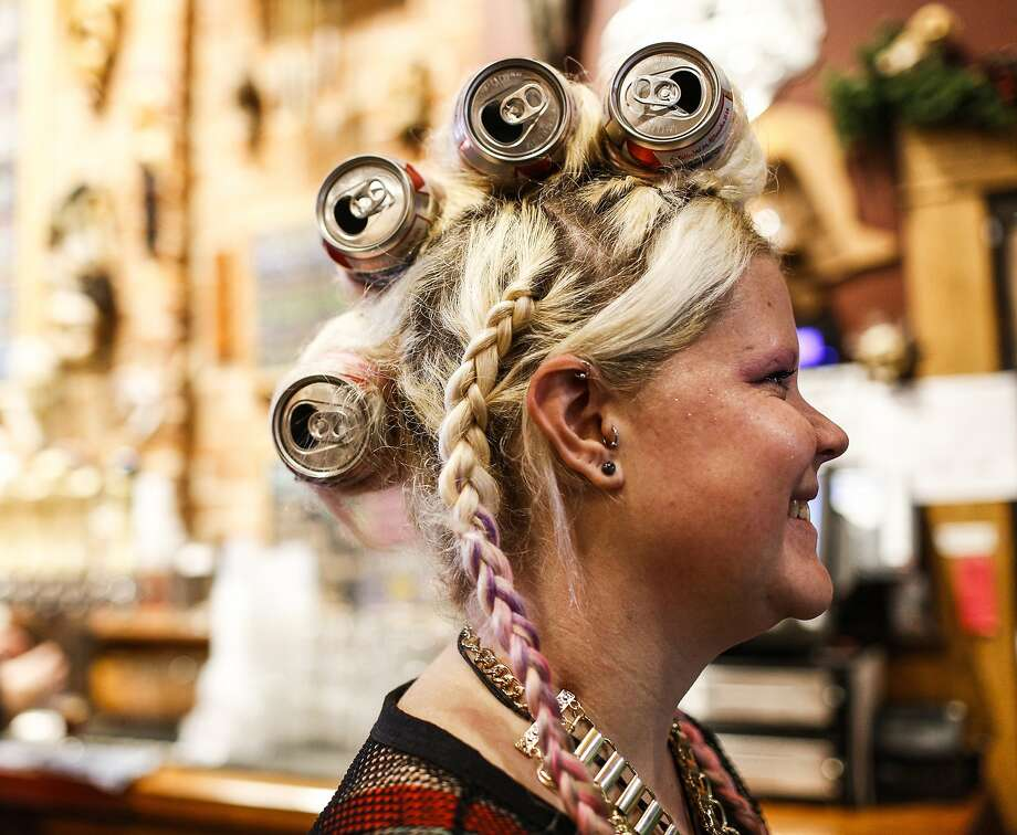 """SHE COIFFED A FEW BREWS: Alyssa Johnston shows off her flip-top hairdo during """"Eccentric Day"""" at   Bell's Eccentric Cafe in Kalamazoo, Mich. Photo: Junfu Han, Associated Press"""