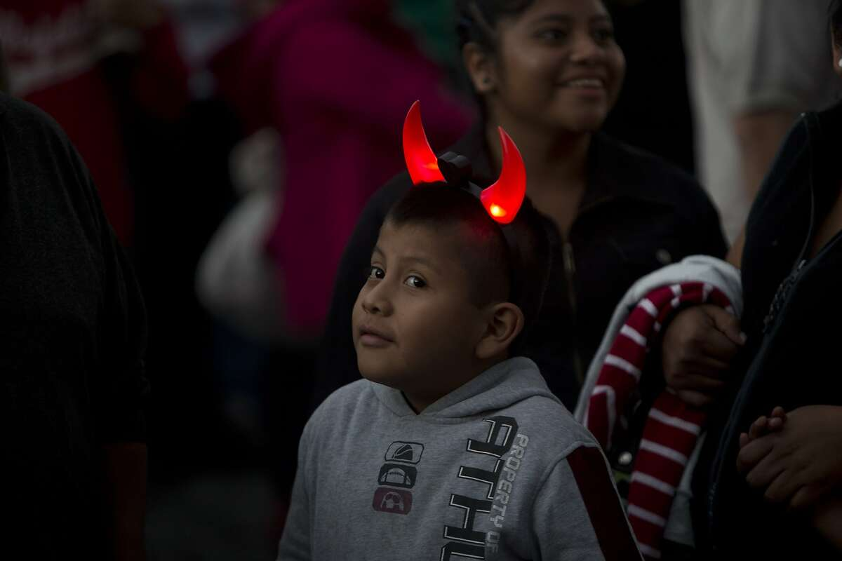 WHY, YES, SANTA, I HAVE BEEN A GOOD BOY THIS YEAR: Guatemalans celebrate the Virgin of the Immaculate Conception festival - the traditional beginning of the Christmas season - in Antigua.