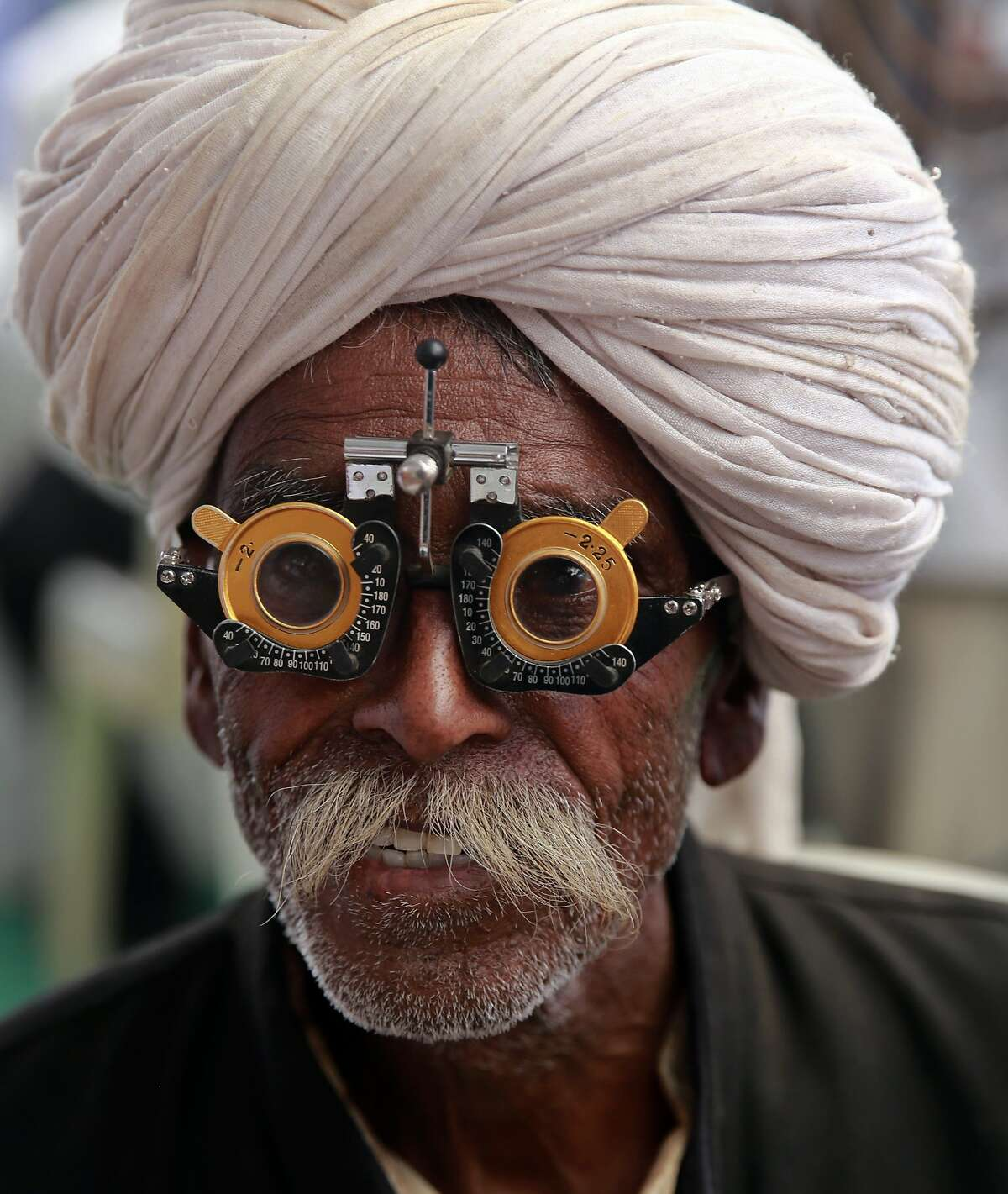 YOU SHOULD HAVE YOUR EYES EXAMINED: An Indian man gets his vision checked at a free medical camp marking the death anniversary of Bhim Rao Ambedkar in Mumbai. Ambedkar, an untouchable, or dalit, and a prominent Indian freedom fighter, was the chief architect of the Indian constitution, which outlawed discrimination based on caste.