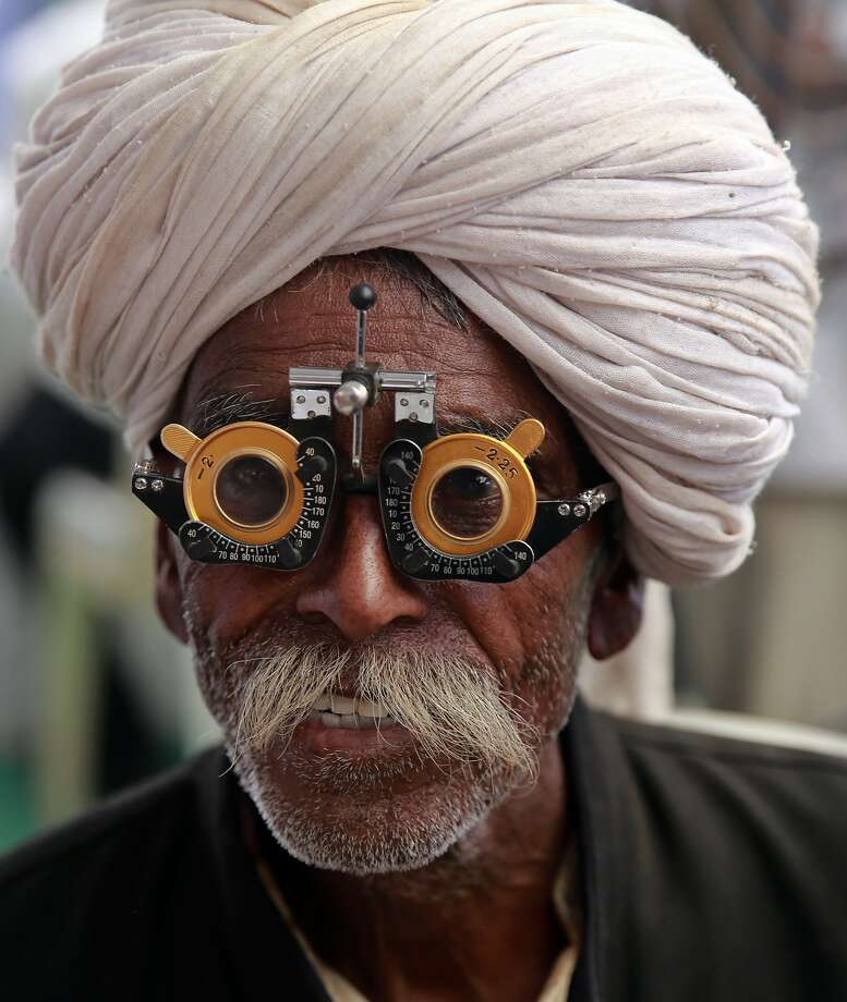 YOU SHOULD HAVE YOUR EYES EXAMINED:An Indian man gets his vision checked at a free medical camp   marking the death anniversary of Bhim Rao Ambedkar in Mumbai. Ambedkar, an untouchable, or dalit, and   a prominent Indian freedom fighter, was the chief architect of the Indian constitution, which   outlawed discrimination based on caste. Photo: Rafiq Maqbool, Associated Press