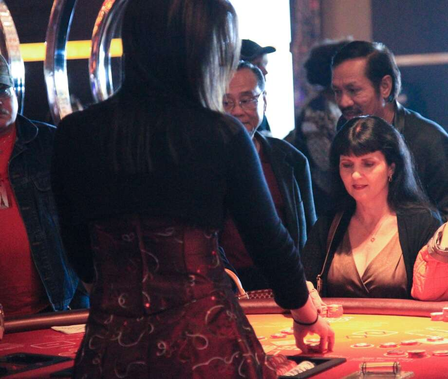 Players hit the tables on the first day at the new Golden Nugget casino in Lake Charles, La. The Casino, built by billionaire Tillman Fertitta, is expected draw large crowds from Houston. Photo: James Nielson / Houston Chronicle