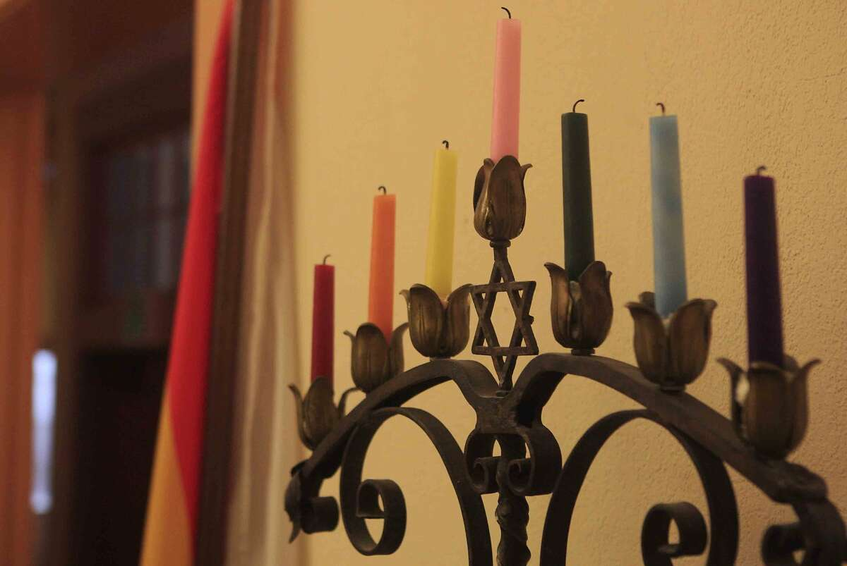 A menorah is adorned with LGBTQI pride-colored candles during the first-ever LGBTQI Jewish Clergy Retreat at Congregation Sha'ar Zahav on Dolores Street in San Francisco, Calif. Monday, December 8, 2014.