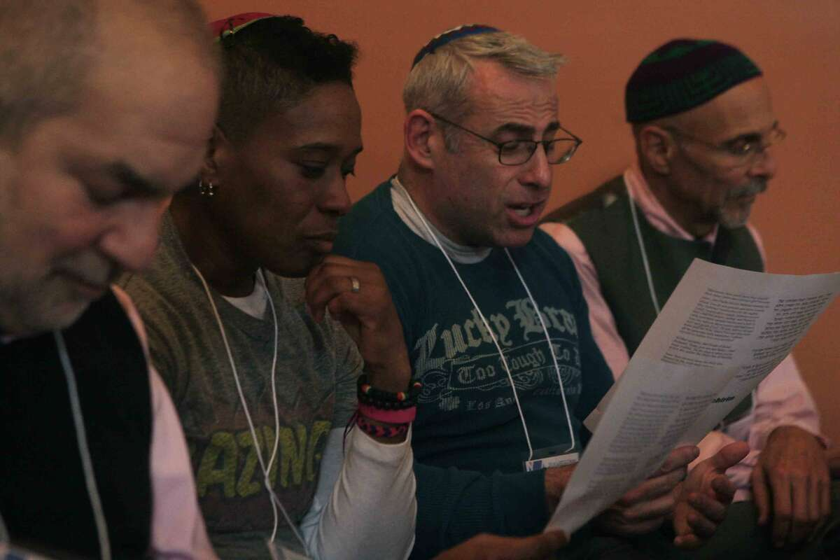 (From left) Jacob Staub of Philadelphia, Sandra Lawson of Philadelphia, Joshua Lesser of Atlanta and Andrew Elias Ramer of San Francisco meet in a group to read over a scripture prompt during the first-ever LGBTQ Jewish Clergy Retreat at Congregation Sha'ar Zahav on Dolores Street in San Francisco, Calif. Monday, December 8, 2014.