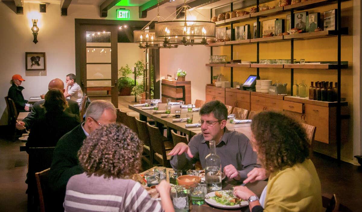 Diners enjoy dinner at Arguello restaurant in San Francisco.