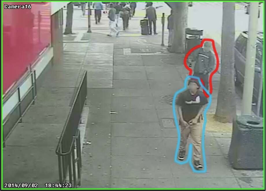 Two suspects, one who is accused of killing Rashawn Williams, 14, are shown in security video, 10 minutes before the killing, near a McDonald's at 24th and Mission Streets, according to the San Francisco Public Defender's Office. The suspect accused of killing Rashawn was outlined in blue. The other person is outlined in red. Photo: San Francisco Public Defender / ONLINE_YES