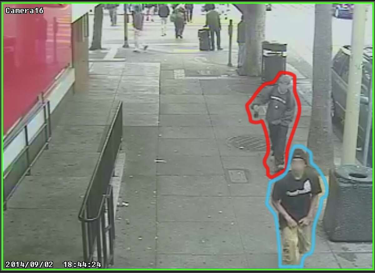Two suspects, one who is accused of killing Rashawn Williams, 14, are shown in security video 10 minutes before the killing near a McDonald's at 24th and Mission Streets, according to the San Francisco Public Defender's Office. The suspect accused of killing Rashawn was outlined in blue. The other person is outlined in red.