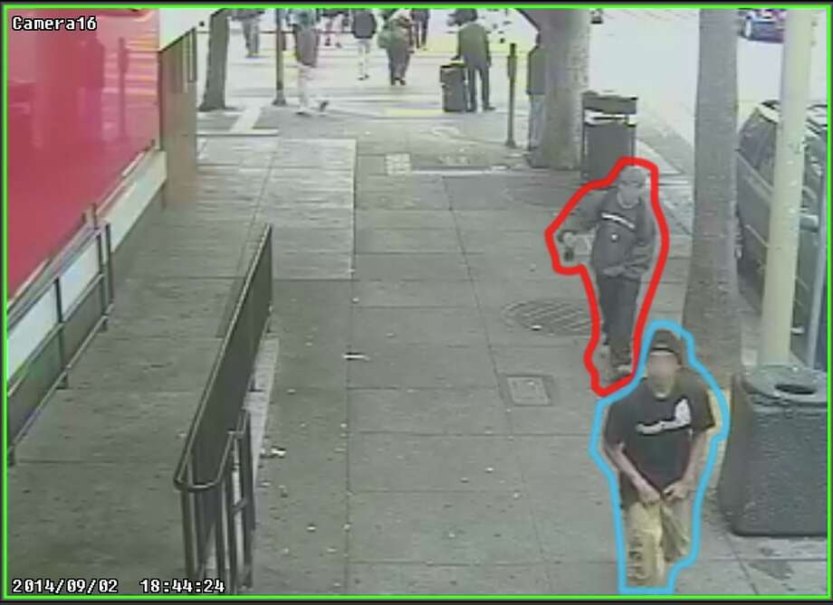Two suspects, one who is accused of killing Rashawn Williams, 14, are shown in security video 10 minutes before the killing near a McDonald's at 24th and Mission Streets, according to the San Francisco Public Defender's Office. The suspect accused of killing Rashawn was outlined in blue. The other person is outlined in red. Photo: San Francisco Public Defender / ONLINE_YES