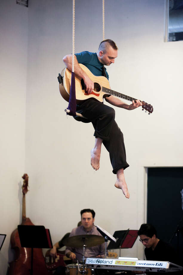 "Josh Grohman does double duty in ""Echo,"" playing in the band and hoisting himself high in the air for an aerial piece. Photo: Julysa Sosa / Julysa Sosa / / Julysa Sosa For the San Antonio Express-News"