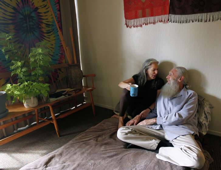 Paul Gowins and his wife Rion are seen at their apartment in Millbrae, Calif. on Saturday, Dec. 6, 2014. The couple, who've been married for 43 years, have regained their financial footing after living out of their Jeep Comanche during a period of homelessness.
