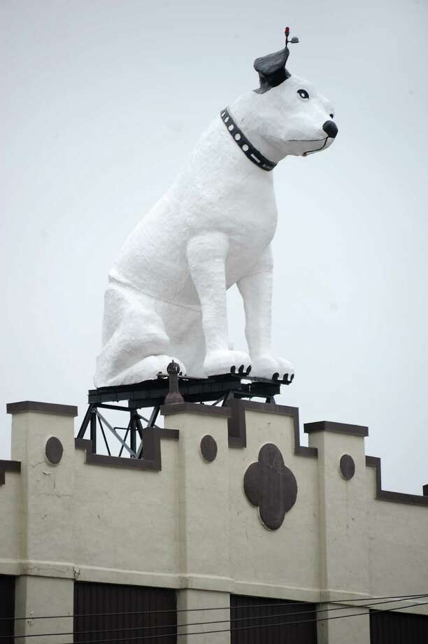 Arnoff Moving and Storage on Broadway is up for sale on Monday, Dec. 8, 2014 in Albany, N.Y. The building is known for its 28 ft fiberglass RCA dog known as Nipper.(Lori Van Buren / Times Union) Photo: Lori Van Buren / 00029782A