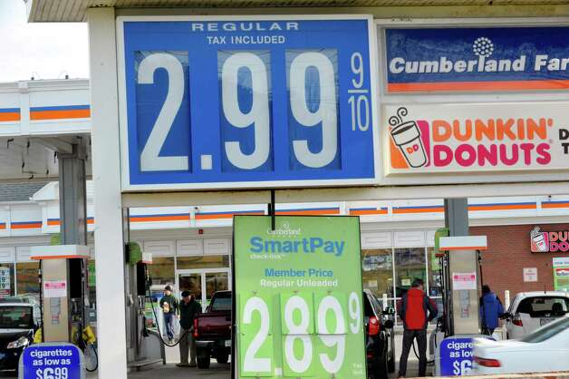 Customers fill up their vehicles with gas at the Cumberland Farms on Monday, Dec. 8, 2014, in Glenmont, N.Y.  (Paul Buckowski / Times Union) Photo: Paul Buckowski / 00029776A