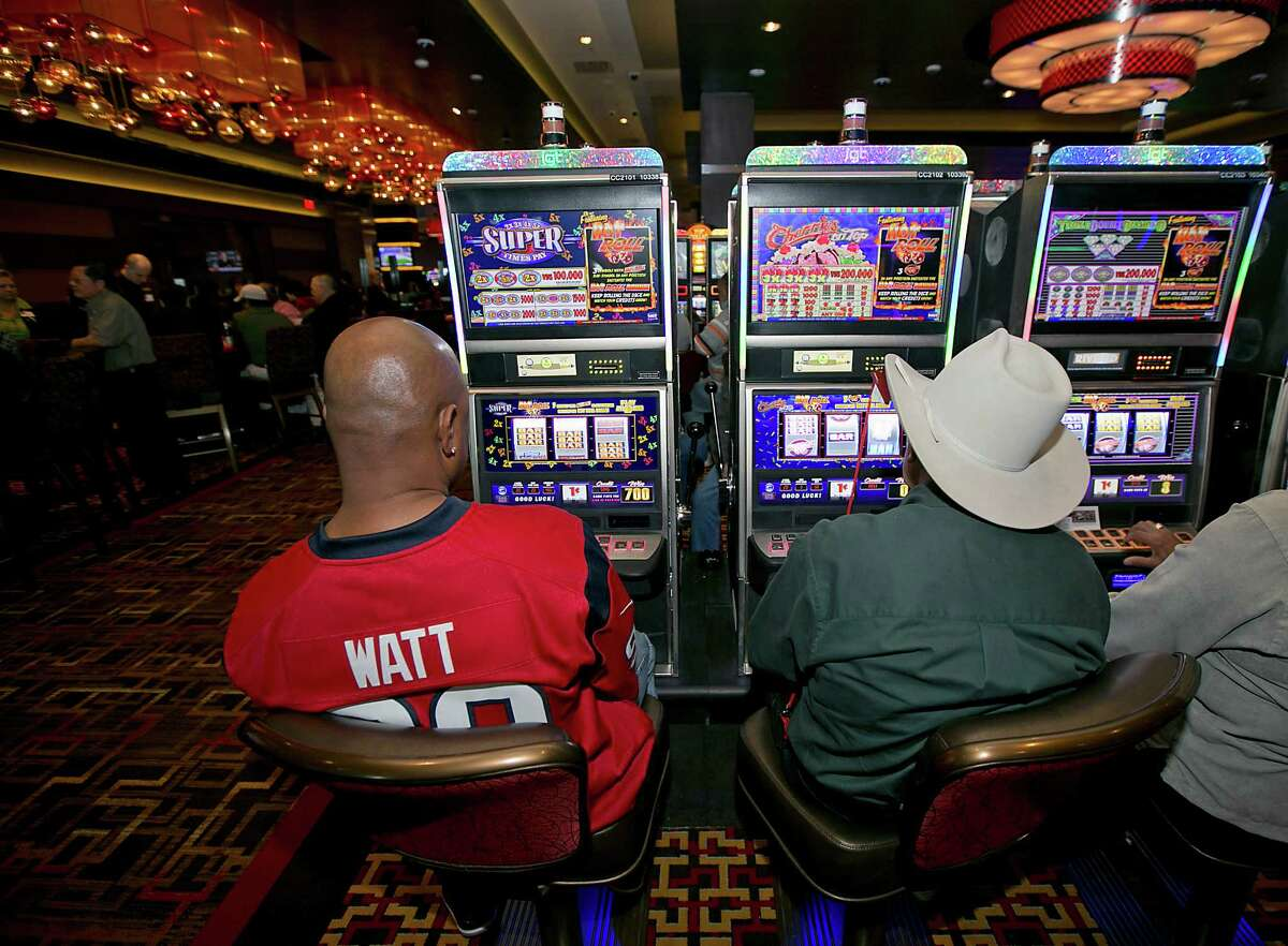 Golden Nugget in Lake Charles, La. Guests play slot machines during the December, 2014, opening of the Golden Nugget in Lake Charles, La. The casino and hotel opened next door to existing casino L'Auberge.