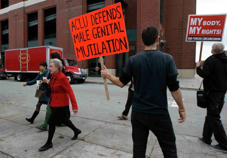 Jonathon Conte and other demonstrators protest Sunday in from of the offices of the approach members of the ACLU during a protest against circumcision held by the group Bay Area Inactivists in front of the ACLU building in San Francisco, Calif. Sunday, December 7, 2014. The ACLU successfully sued to have an initiative to ban circumcision removed from the ballot. Photo: Jessica Christian / The Chronicle / ONLINE_YES