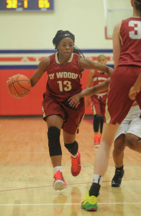 Cy-Woods senior guard Erica Ogwumike, left, drives to the hoop against Atascocita in the 1st quarter of their season-opener at Atascocita High School on Tuesday. Photo: Jerry Baker, Freelance