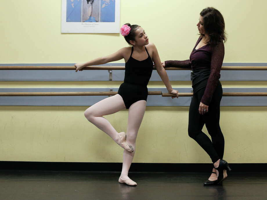 """Olivia Aguirre dances the Clara role and her real-life mother, Jessica Aguirre, dances the role of Clara's mother in the Tiffany Dance Academy's """"Nutcracker"""" production. Photo: Michael Macor / The Chronicle / ONLINE_YES"""
