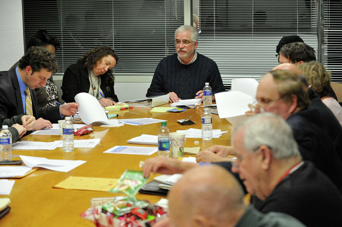 President of the Board of Representatives and Steering Committee Randy Skigen, at the head of the table, chairs the Steering Committee meeting at the Stamford Government Center in Stamford, Conn., on Monday, Dec. 8, 2014.