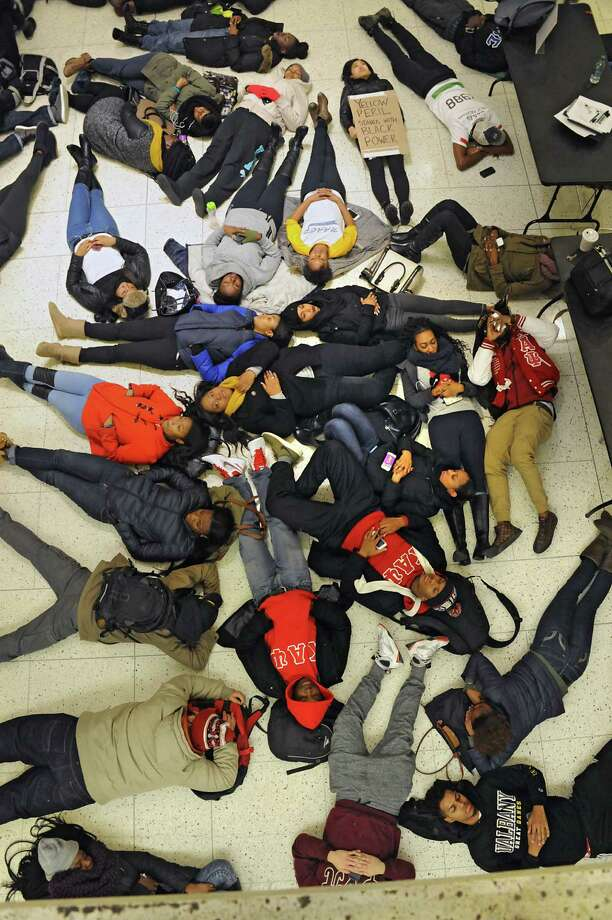 """The National Association For the Advancement of Colored People host a """"die-in"""" to honor the lives of Eric Garner and Michael Brown in the campus center at the University of Albany on Monday, Dec. 8, 2014 in Albany, N.Y. The students participating in the protest laid down on the floor for 11 minutes which was the time it took Eric Garner to die when police put him in a chokehold. (Lori Van Buren / Times Union) Photo: Lori Van Buren / 00029772A"""