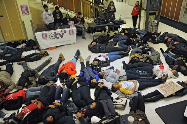 "The National Association For the Advancement of Colored People host a ""die-in"" to honor the lives of Eric Garner and Michael Brown in the campus center at the University of Albany on Monday, Dec. 8, 2014 in Albany, N.Y. The students participating in the protest laid down on the floor for 11 minutes which was the time it took Eric Garner to die when police put him in a chokehold. (Lori Van Buren / Times Union) Photo: Lori Van Buren / 00029772A"