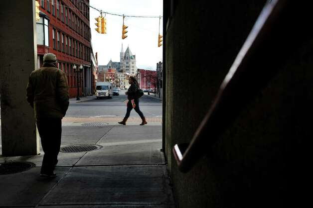 Pedestrians make their way along South Pearl Street in the cold on Monday, Dec. 8, 2014, in Albany, N.Y.  (Paul Buckowski / Times Union) Photo: Paul Buckowski