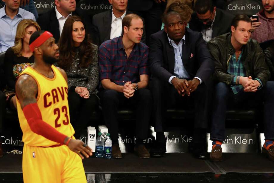 NEW YORK, NY - DECEMBER 08:  Prince William, Duke of Cambridge and Catherine, Duchess of Cambridge watch as LeBron James #23 of the Cleveland Cavaliers looks on during his game against the Brooklyn Nets at Barclays Center on December 8, 2014 in the Brooklyn borough of New York City.  NOTE TO USER: User expressly acknowledges and agrees that, by downloading and or using this photograph, User is consenting to the terms and conditions of the Getty Images License Agreement.  (Photo by Al Bello/Getty Images) ORG XMIT: 508084817 Photo: Al Bello / 2014 Getty Images
