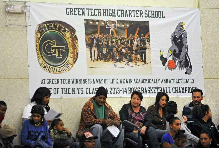 Green Tech fans sit under a banner for their 2014 state Class AA champions during a basketball game against Queensbury on Monday, Dec. 8, 2014 in Albany, N.Y. (Lori Van Buren / Times Union) Photo: Lori Van Buren / 00029773A