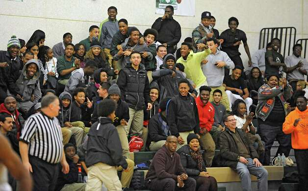 Green Tech fans go wild after Isreal Griffin slam dunks the ball during a basketball game against Queensbury on Monday, Dec. 8, 2014 in Albany, N.Y. (Lori Van Buren / Times Union) Photo: Lori Van Buren / 00029773A