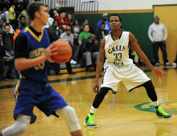 Green Tech's Anquan Mclean, right, guards Queensbury's Keeghan O'Leary during a basketball game on Monday, Dec. 8, 2014 in Albany, N.Y. (Lori Van Buren / Times Union) Photo: Lori Van Buren / 00029773A