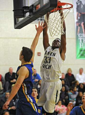 Green Tech's Anquan Mclean slam dunks the ball during a basketball game against Queensbury on Monday, Dec. 8, 2014 in Albany, N.Y. (Lori Van Buren / Times Union) Photo: Lori Van Buren / 00029773A