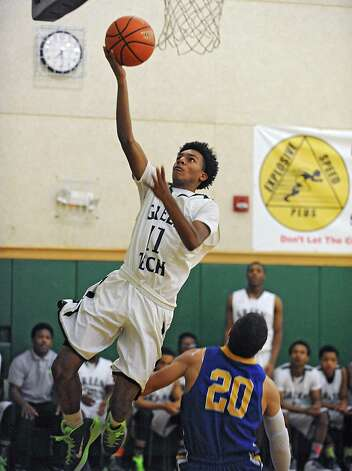 Green Tech's Naeem Pryor goes up for a layup during a basketball game against Queensbury on Monday, Dec. 8, 2014 in Albany, N.Y. (Lori Van Buren / Times Union) Photo: Lori Van Buren / 00029773A
