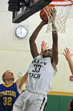 Green Tech's Anquan Mclean drives to the basket for two points during a basketball game against Queensbury on Monday, Dec. 8, 2014 in Albany, N.Y. (Lori Van Buren / Times Union) Photo: Lori Van Buren / 00029773A