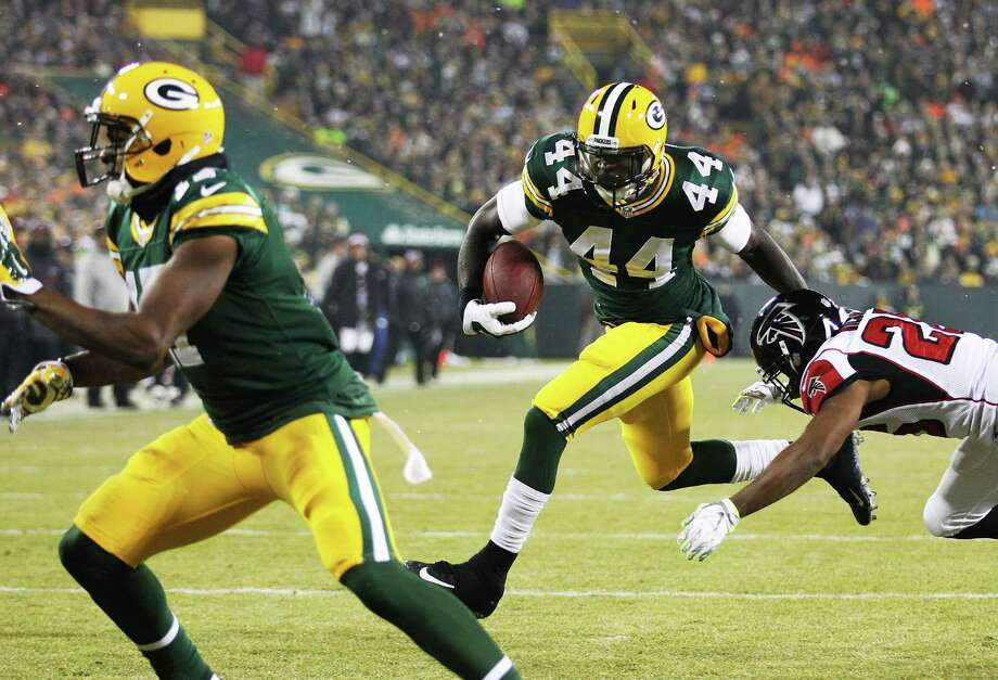 GREEN BAY, WI - DECEMBER 08:   James Starks #44 of the Green Bay Packers carries the ball in for a touchdown in the first quarter against the Atlanta Falcons at Lambeau Field on December 8, 2014 in Green Bay, Wisconsin.  (Photo by Mike McGinnis/Getty Images) ORG XMIT: 507848163 Photo: Mike McGinnis / 2014 Getty Images