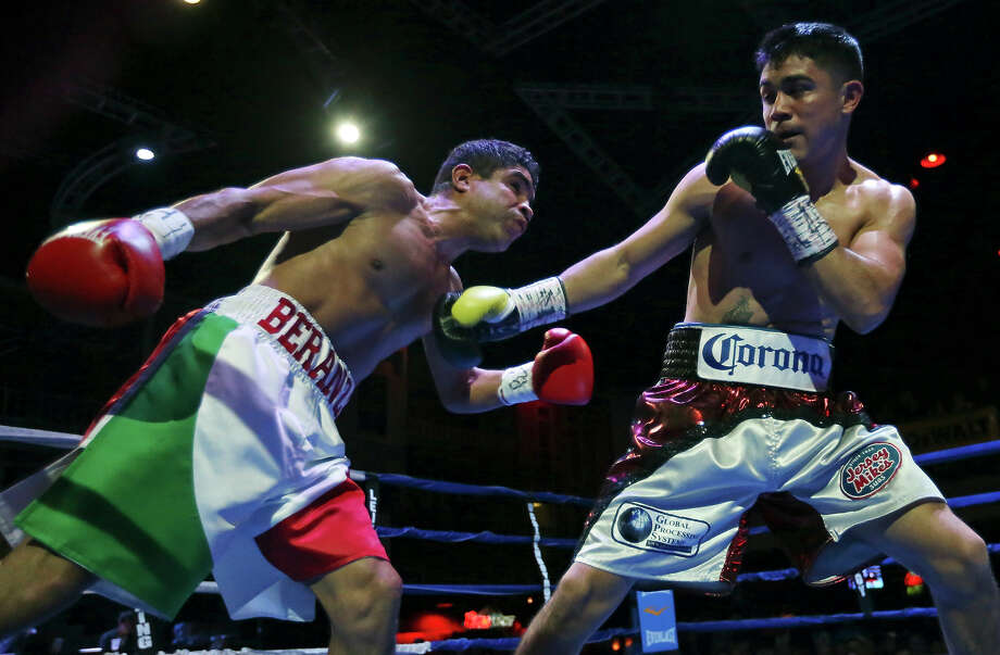 Jose Angel Beranza (left) and Joseph Diaz exchange punches during their junior featherweight bout at Cowboys Dancehall. Photo: Edward A. Ornelas, Staff / San Antonio Express-News / © 2014 San Antonio Express-News