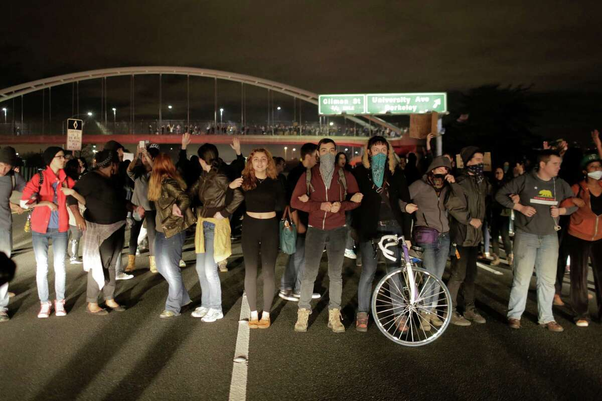 Protesters block traffic on Route 580 in Berkeley, Calif. on December 8, 2014. The protesters were protesting against recent police killings.