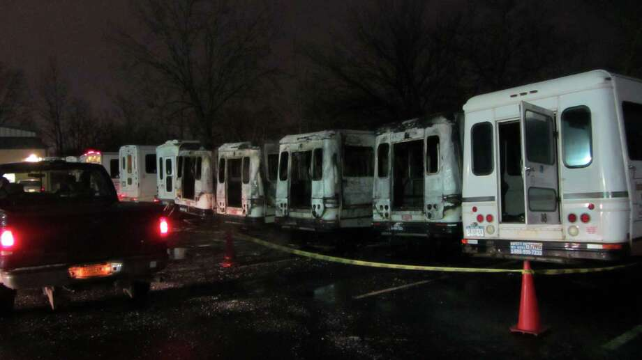 Six vans were badly damaged in an early Tuesday morning fire at the Center for Disability Services on South Pearl Street. The fire at the 700 S. Pearl St., facility was first reported at 2:22 a.m. The cause of the blaze remains under investigation. (Bob Gardinier / Times Union)