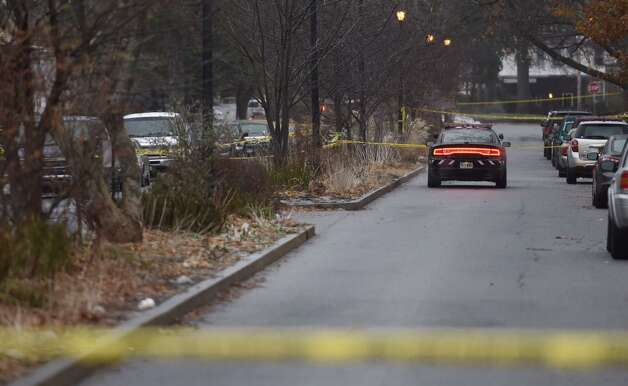 Crime scene tape closes Parkwood Boulevard in Schenectady after an early morning killing on Tuesday, Dec. 9, 2014. (Skip Dickstein / Times Union)