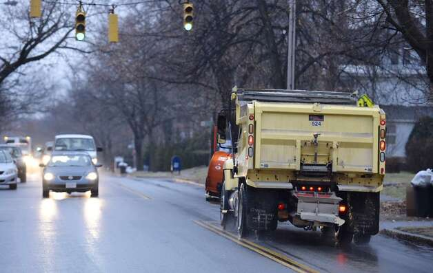 A salt truck tries to keep up with the freezing drizzle that left slick many streets in the Capital Region early Tuesday. (Skip Dickstein / Times Union)
