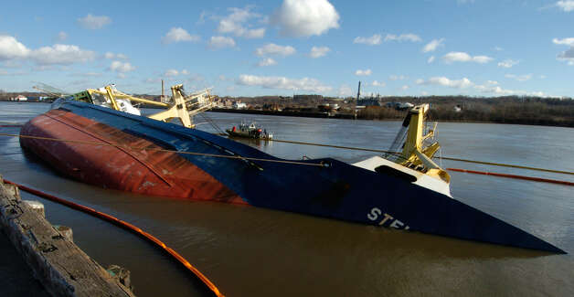 TIMES UNION STAFF PHOTO BY SKIP DICKSTEIN - The cargo ship Stellamare sits quietly on its side in the Port of Albany, New York and still holds the answers to the whereabouts of three missing sailors from its crew December 12, 2003 ORG XMIT: MER2013120907231484 ORG XMIT: MER2013120907320844 Photo: SKIP DICKSTEIN / ALBANY TIMES UNION