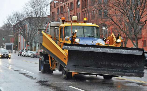 A NYS DOT snow plow patrols Brodway ready for the coming storm Tuesday Dec. 9, 2014, in Saratoga Springs, NY.  (John Carl D'Annibale / Times Union) Photo: John Carl D'Annibale / 00029785A