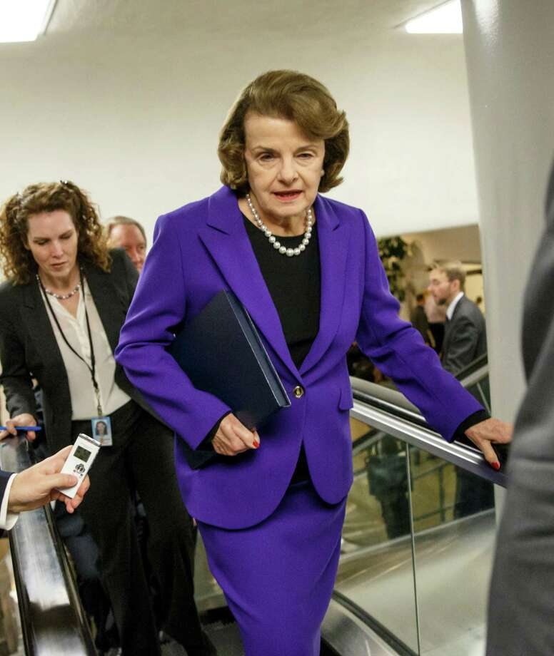 Senate Intelligence Committee Chair Sen. Dianne Feinstein, D-Calif. is pursued by reporters on Capitol Hill in Washington, Tuesday, Dec. 9, 2014, as she arrives to release a report on the CIA's harsh interrogation techniques at secret overseas facilities after the 9/11 terror attacks. Photo: J. Scott Applewhite / Associated Press / AP