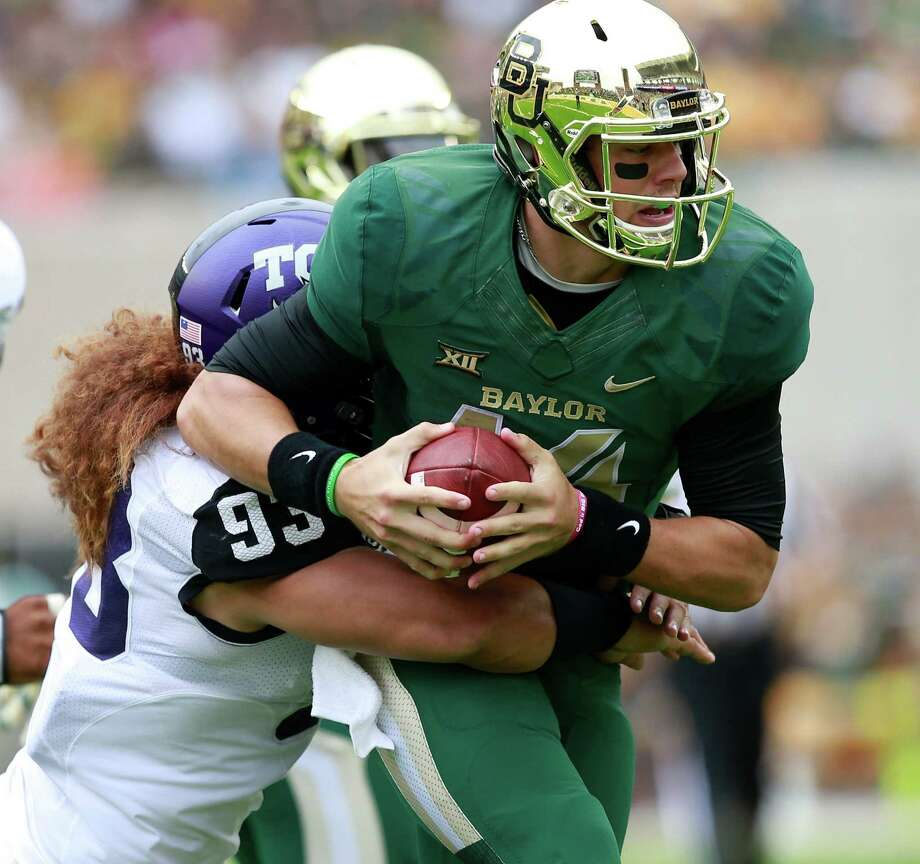 Baylor quarterback Bryce Petty (14) is pulled down by TCU defensive end Mike Tuaua (93) during the first half of an NCAA college football game, Saturday, Oct. 11, 2014, in Waco, Texas.Continue clicking to see the colleges with the most student athlete arrests. Photo: Jose Yau, Associated Press / Waco Tribune Herald