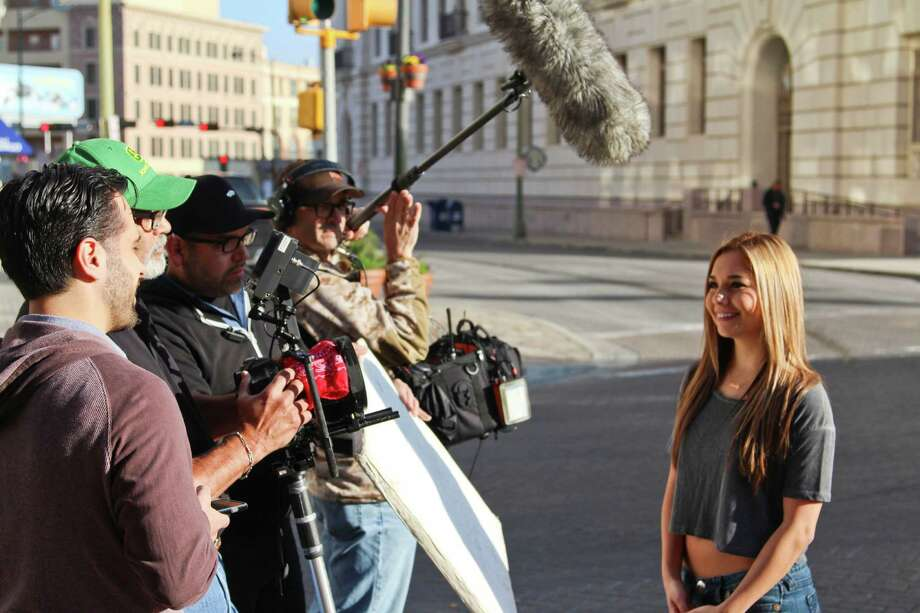 A camera crew works at the corner of Alamo and Houston in downtown San Antonio to shoot a new set of commercials for Taco Cabana. Photo: Tyler White/San Antonio Express-News