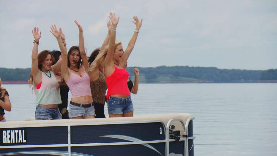 San Antonio's Tessa Moss (in white shirt, left) gets jovial with fellow contestants of Season 4 of 'Redneck Island.' Photo: CMT / CMT