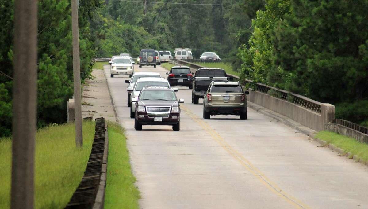 Traffic crosses the Spring Creek bridge on Kuykendahl Road between Montgomery and Harris counties.