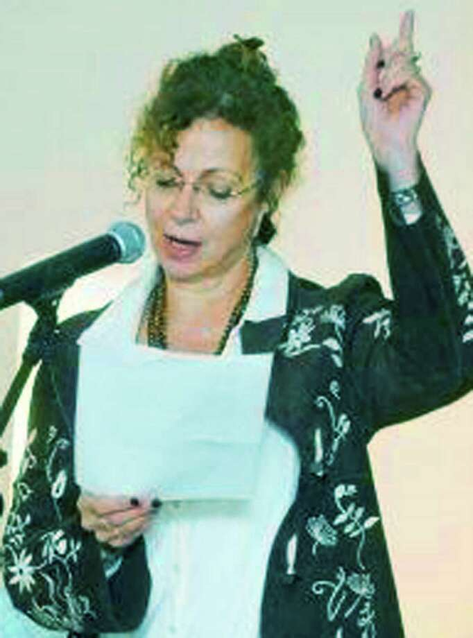 Kristen DeVoe of Bridgewater reads her poetry Saturday, Nov. 15 during the Voices for Poetry's benefit event for the Loaves & Fishes Hospitality House in New Milford.  Photography by Scott Mullin Photo: Contributed Photo / The News-Times Contributed