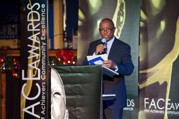 Sylvester Turner presents a F.A.C.E Award at Neon Boots in Houston TX, Monday December 8, 2014.