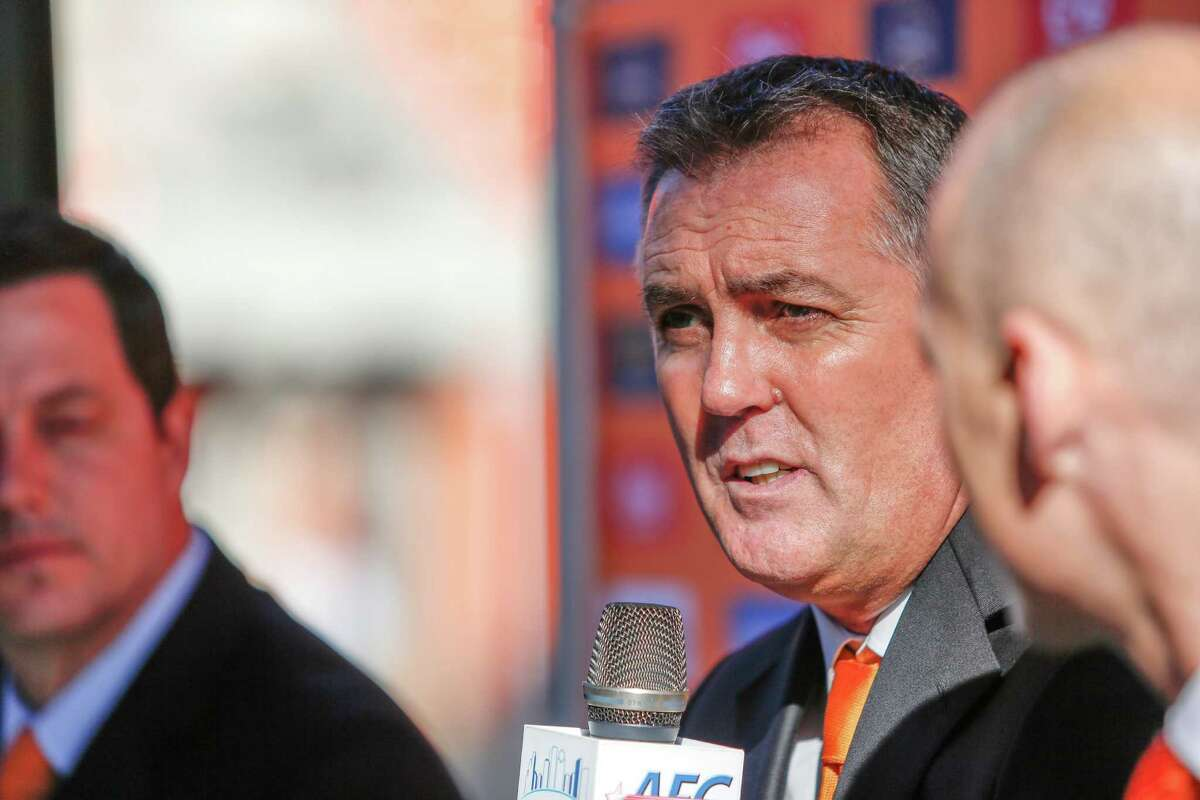The Dynamo introduce new coach Owen Coyle at a news conference at BBVA Compass Stadium, Tuesday, Dec. 9, 2014 in Houston.
