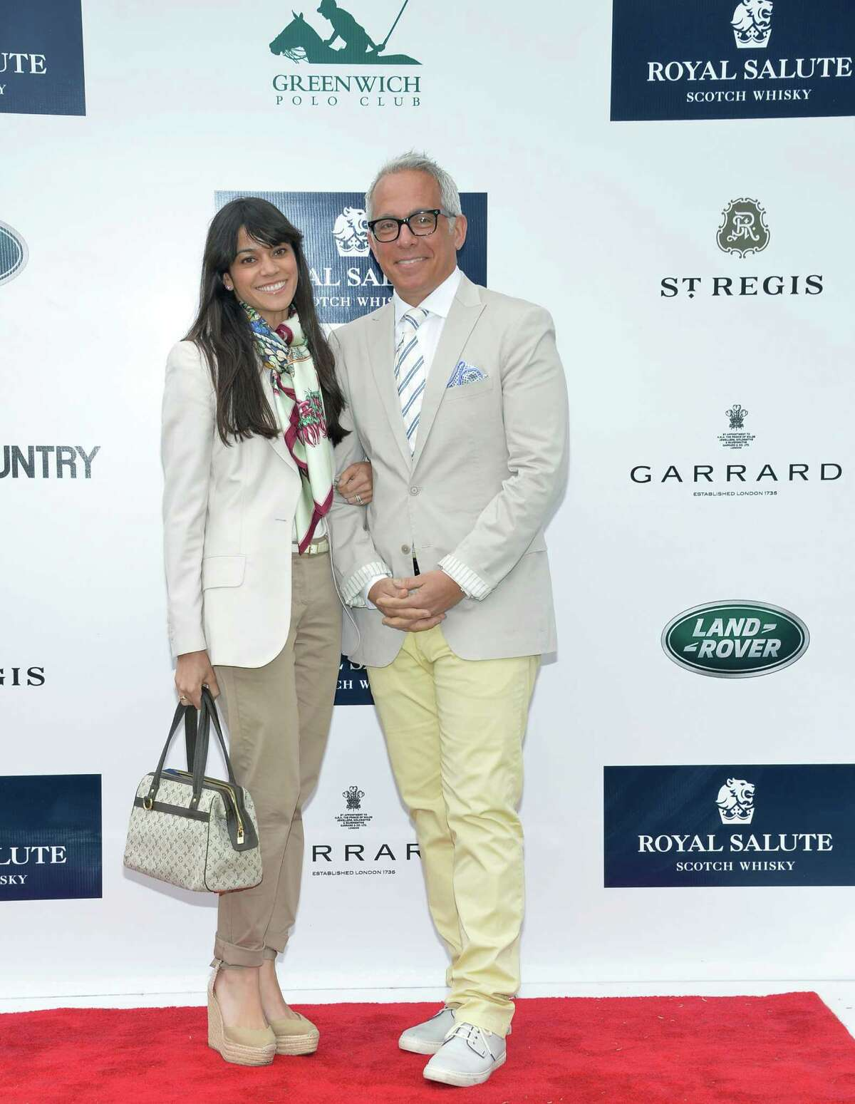 GREENWICH, CT - MAY 15: Margaret Anne Williams and Chef Geoffrey Zakarian attend the The Sentebale Royal Salute Polo Cup at The Greenwich Polo Club on Wednesday 15th May. The Sentebale Land Rover team was captained by Royal Salute Ambassador Malcom Borwick with team members Mark Ganzi, Michael Carrazza and Prince Harry, one of the founding Patrons of Sentebale. The St. Regis polo team was captained by Sentebale's Ambassador Nacho Figueras with team members Peter Orthwein, Steve Lefkowitz and Dawn Jones. Royal Salute played host to a number of high profile celebrities. Royal Salute World Polo is a global programme, which now supports tournaments across four continents. The luxury Scotch's involvement with Polo is founded on the game's incredible power, skill and elegance; qualities which blend perfectly with Royal Salute Scotch Whisky, at Greenwich Polo Club on May 15, 2013 in Greenwich, Connecticut.