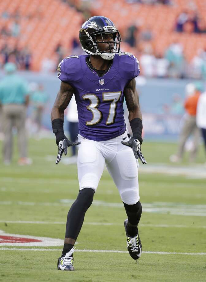 Baltimore Ravens defensive back Danny Gorrer (37) warms up before an NFL football game against the Miami Dolphins, Sunday, Dec. 7, 2014, in Miami Gardens, Fla. (AP Photo/Lynne Sladky)
